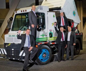 Michael Matkovic and Spiro Kattan of the New York City Department of Sanitation, Global Environmental Products president and CEO Walter Pusic (center with arm upraised), deputy Sanitation commissioner Rocco DiRico of New York,  and US Hybrid president and CEO Dr. Abas Goodarzi, at top right.
