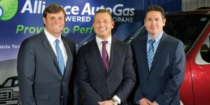 Blossman Gas president and CEO Stuart Weidie with Bart van Aerie, CEO of Prins, and  Yvon Boisclair, president of BL Energie.