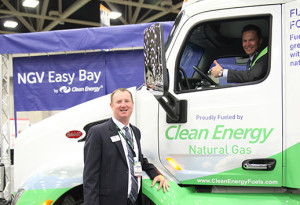 Clean Energy Fuels VP Chad Lindholm in the driver's seat (note green seat belt) of the CNG Peterbilt at ACT Expo 2015 last week in Dallas. Maintenance maestro Wally Dubno is at left (note NGV Easy Bay curtain).