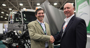 Power Solutions International COO Eric Cohen and Powertrain Integration president Bob Pachla celebrated the deal at ACT Expo 2015 in Dallas.