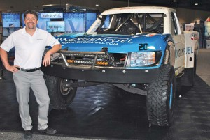 Pat O'Keefe of NexGen-Golden Gate Petroleum with renewable diesel-powered Baja 1000 'trophy truck' at Booth 923.