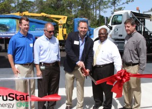 TruStar Energy's Anthony Flynn (far left) and J.J. Taylor's Jose Rivera look on as TruStar Energy president Adam Comora cut the ribbon at the new TruStar-branded CNG outlet in Fort Myers, Fla. this past Thursday. Fort Myers City Councilman Johnny Streets and Keith Gruetzmacher of Teco Peoples Gas are at right.